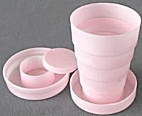 collapsable drinking cup. with a pill box in the center of the lid