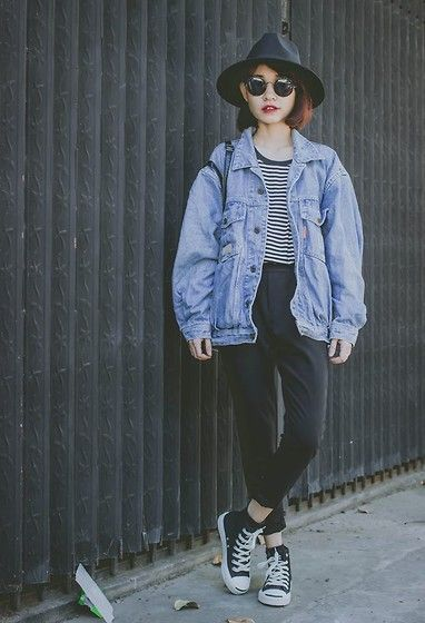 Oversized denim jacket + black and white stripe tee + black high-waisted pants + sneakers