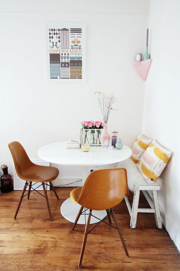 i hate those brown chairs but i love the set up of the small bench and round table for a dining space