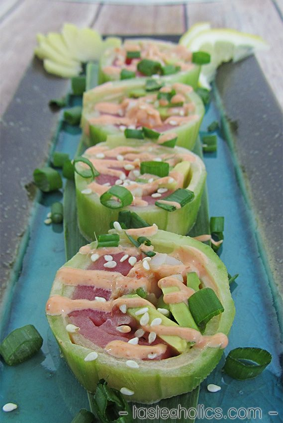 Cucumber wrapped sushi is ‪‎low carb, paleo‬ and versatile. Fill it with all your favorite ingredients and create a new roll! Our roll is filled with tuna, shrimp and avocado and topped with spicy mayo! www.tasteaholics.com