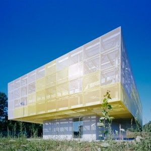 Truck-driving school building topped with a perforated aluminium canopy.