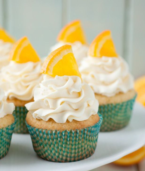 Happy Creamsicle Day! These orange creamsicle cupcakes are a fun take on the frozen treat.