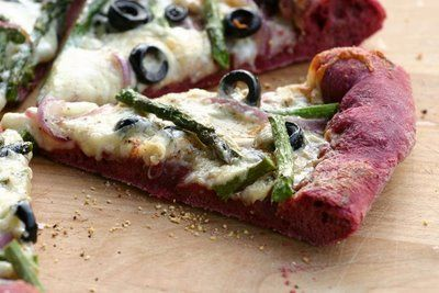 Purple Pizza - Asparagus & Fontina, red onions, olives, garlic cream sauce and beets make the dough purple