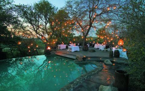 Dining under twinkling lights at Singita Boulders Lodge