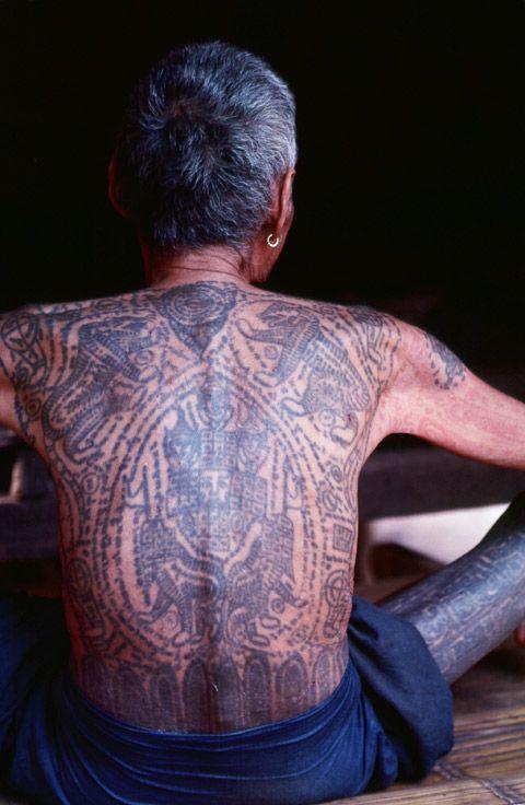 Asia | An elderly tattooed Burmese man, Burma /Myanmar