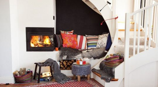 ~The space under the stairs has been transformed into a cozy seat. a small heater under the stairs with cozy corner?~