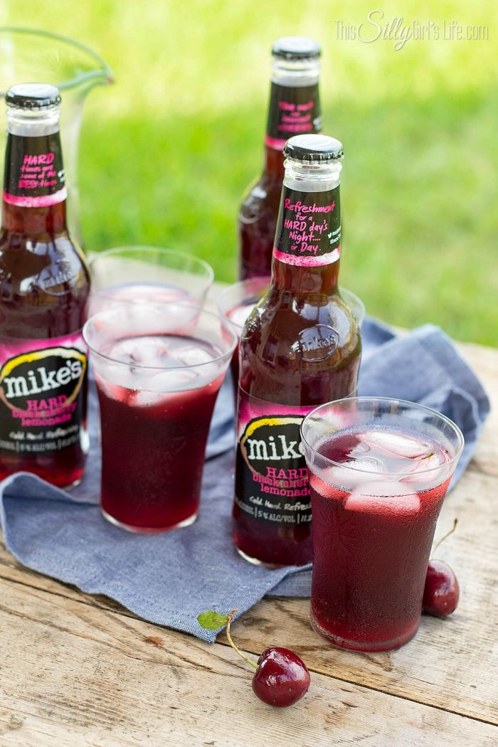 Black Cherry Sangria, fresh cherries, pineapple juice and Mike's Hard Black Cherry Lemonade, this sangria is sweet, refreshing and bursting with summer flavors! - ThisSillyGirlsLife.com #ad #mikesbackyard #mikesVIP