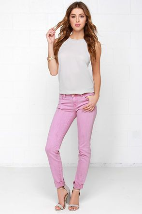 "One look at the Stole My Heart Orchid Purple Skinny Jeans and its pop of purple will have your heart saying ""Denim, Denim""! A flattering mid-rise design tops these brightly-colored pants, featuring a classic five-pocket cut with hidden zip fly, and shiny gold hardware. Light distressing on front and back adds interest to the skinny pant legs. Unlined. 98% Cotton, 2% Spandex. Machine Wash Cold or Dry Clean. Imported."
