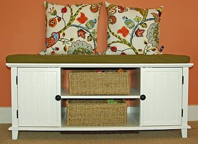 Entertainment center converted into cute storage bench @Dena Riccobene how about this for your mud room area until you figure something out?