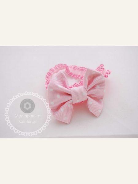 Φιογκάκι πικέ ροζ με λευκό πουά , λαστιχένια στέκα ιδανική για μωρά.
