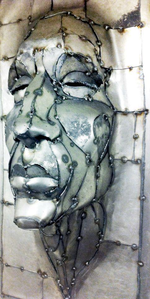 Wisdom  metal art sculpture $1200 16 x 36 x9 created by Joel Sullivan Irondesign