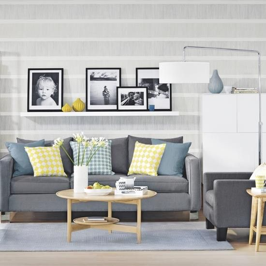 Grey living room with graphic stripe wallpaper and picture shelf