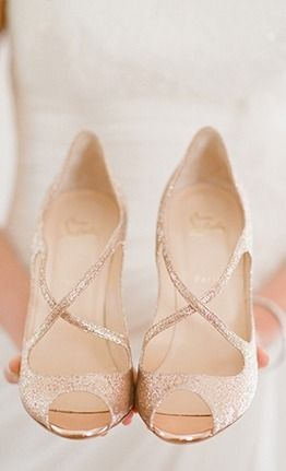 On your wedding day, take the gold details to the dance floor with a fabulous pair of glittering pumps like these by Christian Louboutin.