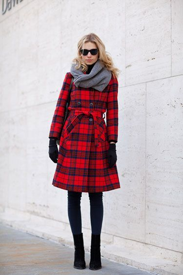 Street Style: New York Fashion Week. Black leggings. Black boots. Gloves. Scarf. Plaid coat. Red and grey.