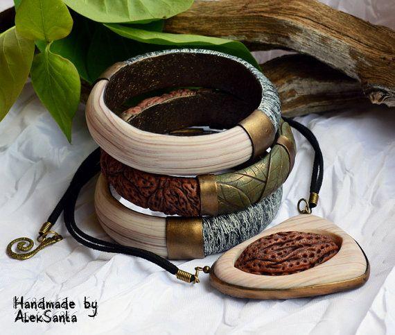 Polimero argilla gioielli set polimero argilla bangle Bracciale polimero argilla Organic jewelry set ciondolo organici organici bracciale ciondolo foglia gioielli gioielli per le donne regalo per i suoi gioielli di istruzione set bracciale istruzione istruzione ___________________________________________ Un set di Gioielli inconsueti è fatto di argilla del polimero e si compone di un grande pendente e tre braccialetti che si completano a vicenda. Forme e texture del set di imitare i…