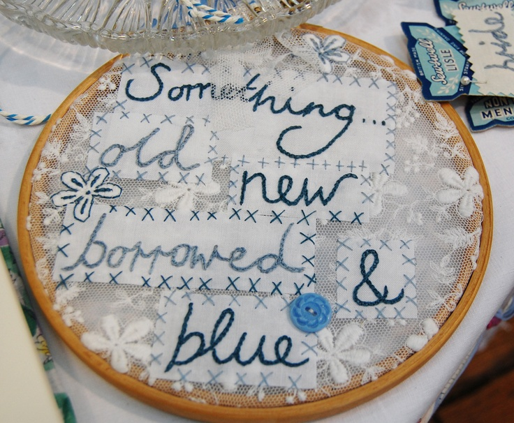 hand stitched by the button tin weddings...