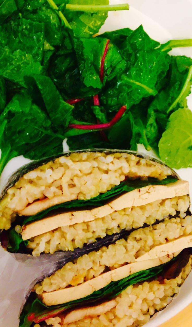 Vegan onigirazu- seaweed sandwich, short grain brown rice, Trader Joe's teriyaki tofu, power greens salad, king oyster mushroom filling.