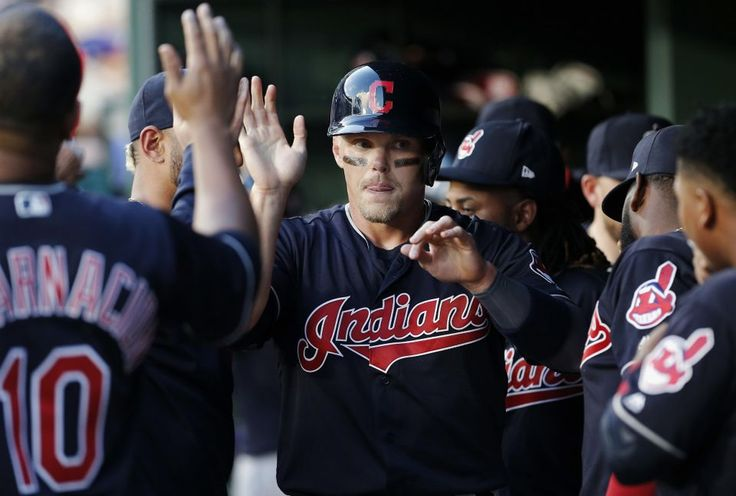 Cleveland Indians Brandon Guyer, center, is congratulated by teammates after scoring on an RBI single by Austin Jackson during the second inning Tuesday, April 4, 2017, in Arlington, Texas. (AP Photo/Brandon Wade) Indians won 4-3