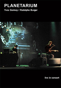 The musicians Yves Dormoy and Rodolphe Burger have worked together since the 1980s in Strasbourg, France, with various forms from jazz to rock. The Planetarium project, the result of work at the Cité des Sciences in Paris in September 2003, brings together their musical research around computers, clarinette, saxophone (Dormoy), electric guitar and vocals (Burger). The DVD presents two recent concerts based on this creation.