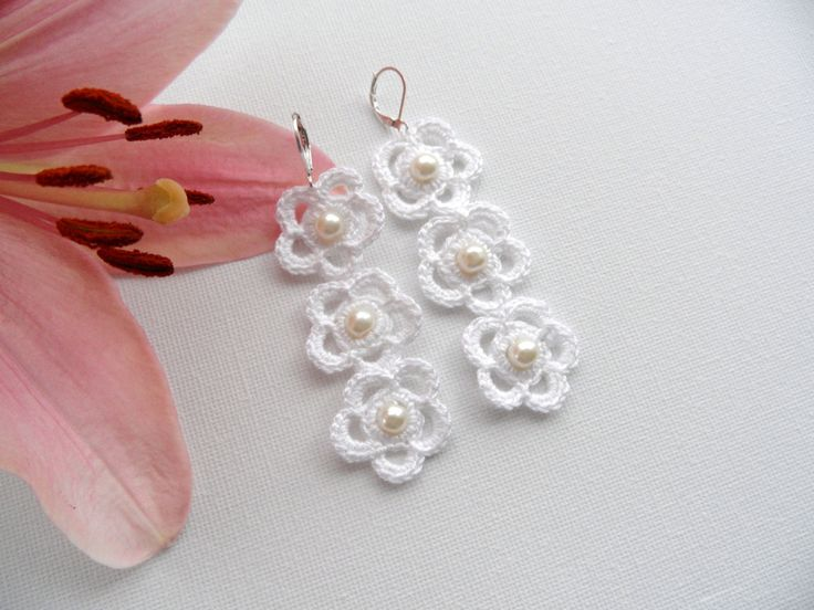 Hand crocheted with snow white 100% Cotton thread and finished with white pearl glass beads this set is light and comfortable to wear.    Each