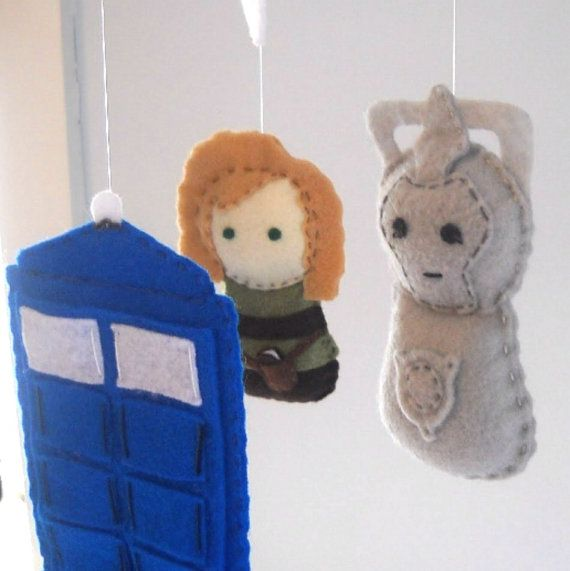 Dr. Who mobile Baby Crib Mobile Tardis Doctor Who by FoxFluff. $90? I think we can get felt and polyfil and MAKE this!