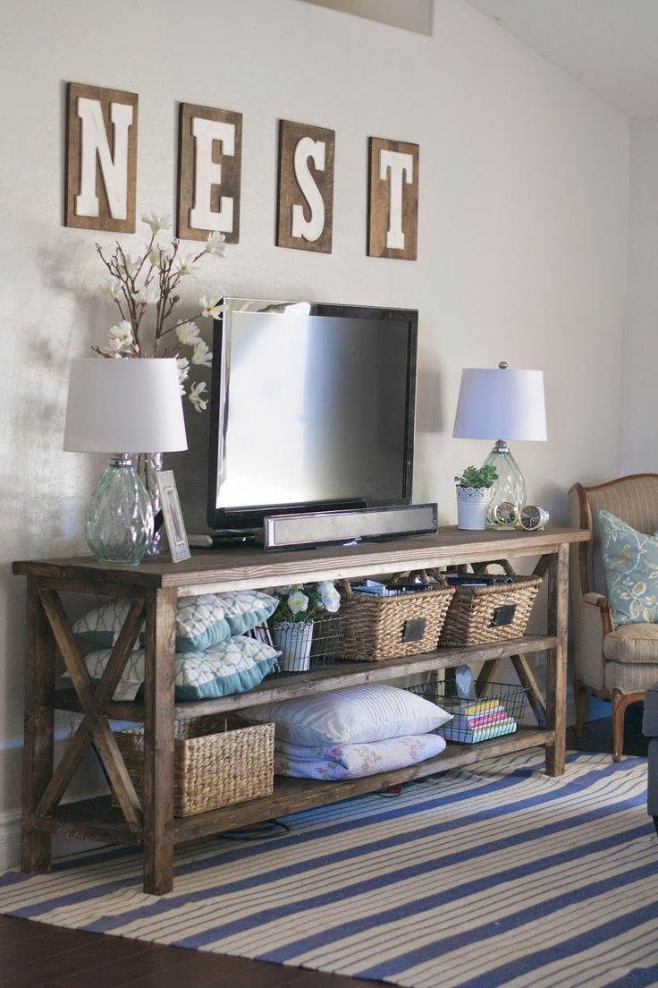 Best 25 tv console decorating ideas on pinterest for Living room 7 letters