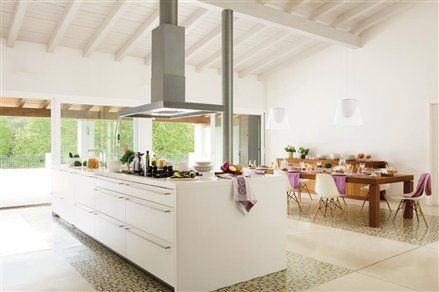 Large central island in spacious kitchen, with patterned flooring helping to break up the expanse #kitchen #island #dining #storage