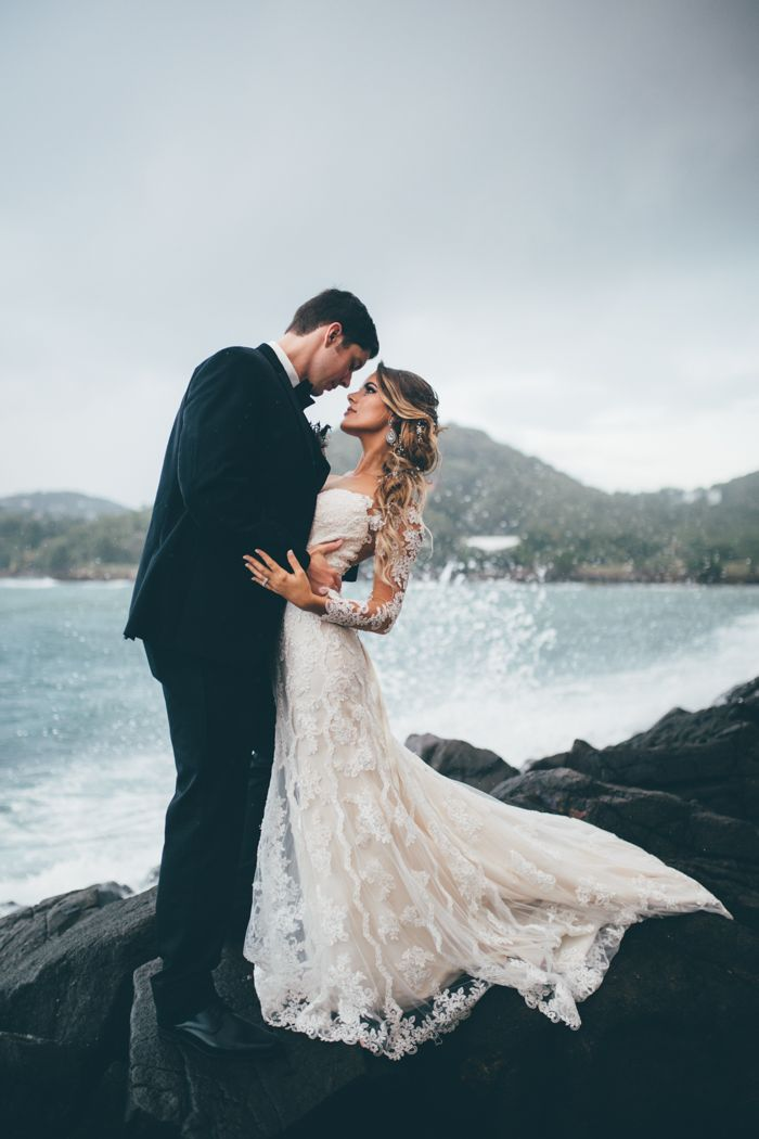 This St. Lucia wedding features incredible seaside views, an etheral Lord of the Rings-inspired bridal style, and romantic marsala accents.