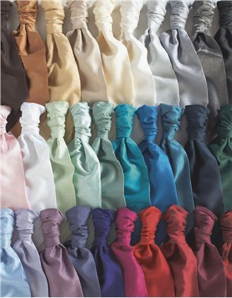 1860 hire by Greenwoods. Top Row (Left to right): Chocolate brown, Orange,  Gold, Coffee, Champagne, Ivory, Platinum, Silver, Slate Shimmer, Black. Middle Row (left to right):Pink, White, Mint, Aqua, Sage, Turquoise, Royal Blue, Teal, Navy, Dark Green. Bottom Row (left to right): Sky Blue, Lilac, Lavender, Grape, Purple, Fuchsia, Scarlet, Claret, Burgundy, Ruby Shimmer.
