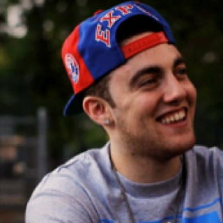 Mac Miller! He's gorgeous, he's my age-ish, he has tattoos, he's white & can rap, and has rythym. Marry me! Haha