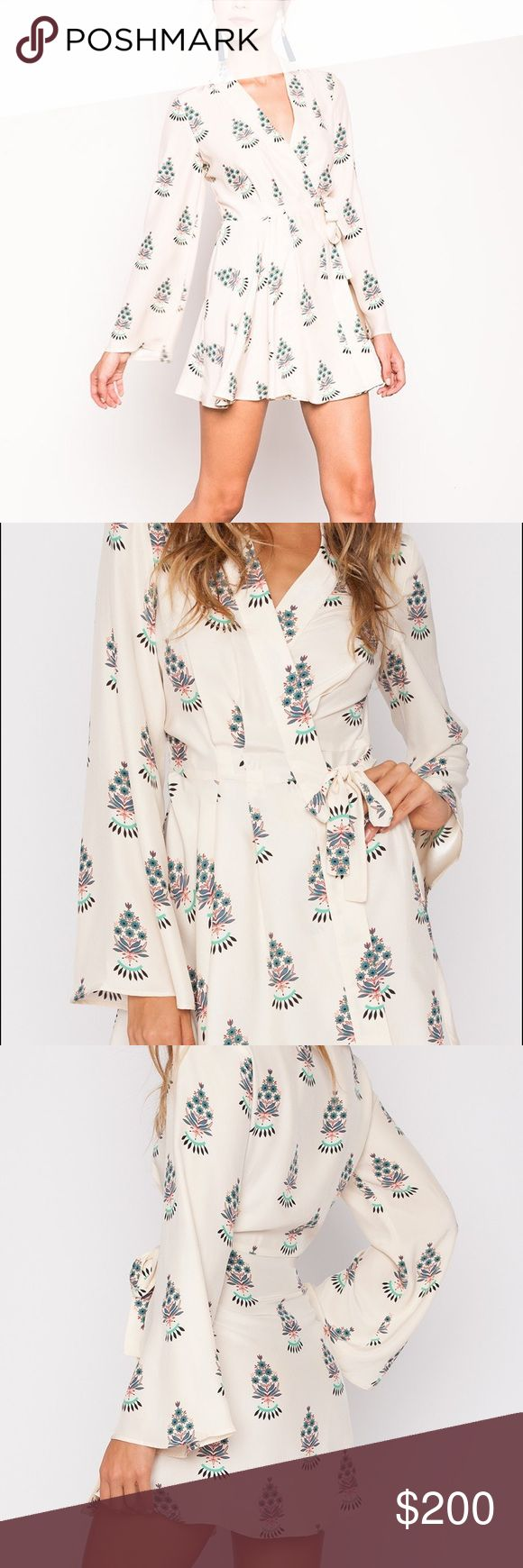 """Stone Cold Fox Fleur Hamlet wrap dress SUPER CUTE wrap style dress, however it's too short on me unfortunately due to my curvy bottom half. It is a size """"2"""" which would fit a size small or medium. Wish I could have made it work!! Stone Cold Fox Dresses Mini"""