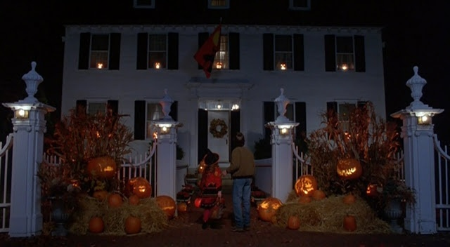 Colonial style house decked out for Halloween.