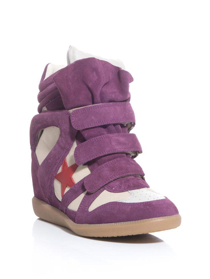 Get your kicks de style d'avant-garde avec ces espadrilles pourpres coin de Bayley Isabel Marant. Un favori de mode culte, cette paire gardera votre bang pansement de repos sur la tendance de l'ES13.