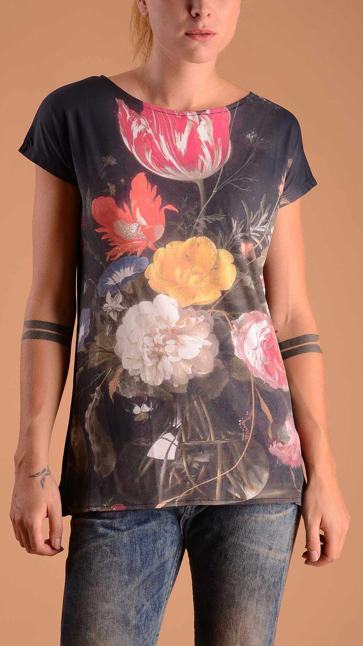Tee Trend Crew neck T-shirt with multicoloured flower print. Front 100% polyester, back 100% cotton.