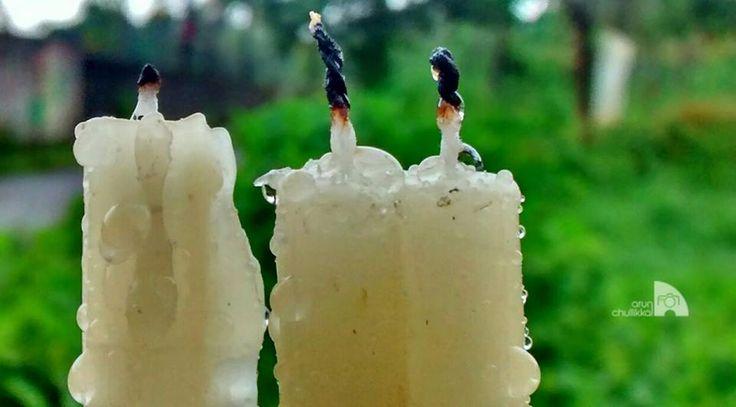 ഒരുമഴയിലണഞ്ഞു പോകുന്ന തിരിനാളങ്ങൾ ചിലതുണ്ട് ജീവിതത്തിന്റെ വഴിവക്കുകളിൽ ചിലരുടെ പ്രാർത്ഥനകൾ  നെഞ്ചേറ്റി നിന്നിരുന്നവ  Photography by Arun Chullikkal