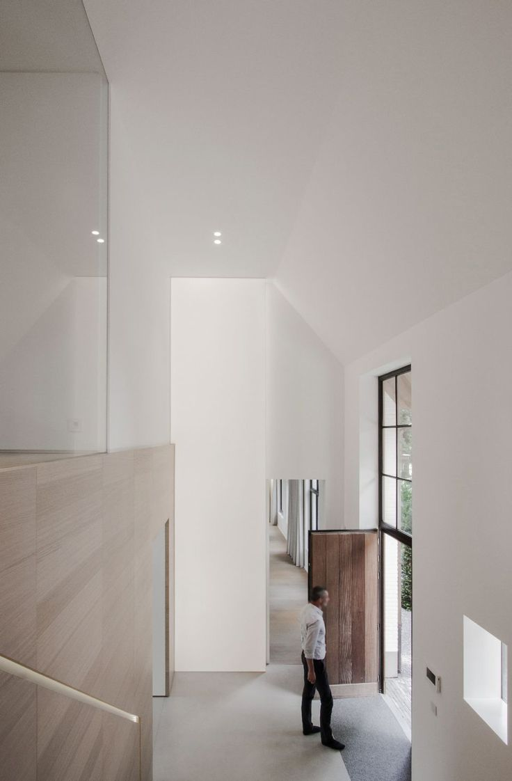 Foyer Minimalist Guide : Minimalist belgian entryway by contekst photo nils van