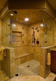 Traditional Master Bathroom steam shower, roll in handicapped accessible access,  ½in glass enclosure, marble bench seat with pebble floor tile and travertine wall tiles hand held shower with body sprays