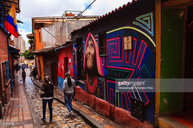 Stock Photo : Bogotá, Colombia - Local Colombians Walk Through The Narrow, Colorful, Cobblestoned Calle del Embudo In The Historic La Candelaria District