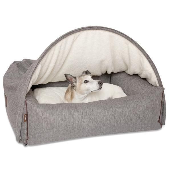 Does your dog like to sleep under the covers? They will love the Kona Cave, Snuggle Cave Dog Beds. These luxury dog beds, made with the highest quality upholstery fabrics, have a beautiful exterior design, a soft, plush and furry pillow and inner cave cover for ultimate pup comfort, plump sides for support, and a brilliant air vent in the back for fresh air at all times. Beautifully designed, to look gorgeous in your home. Both you and your pet will love it! (Fully washable!)