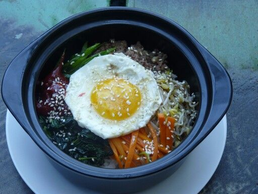 Bibimbap - Korean mixed rice with vegetables, beef and sunny set up.