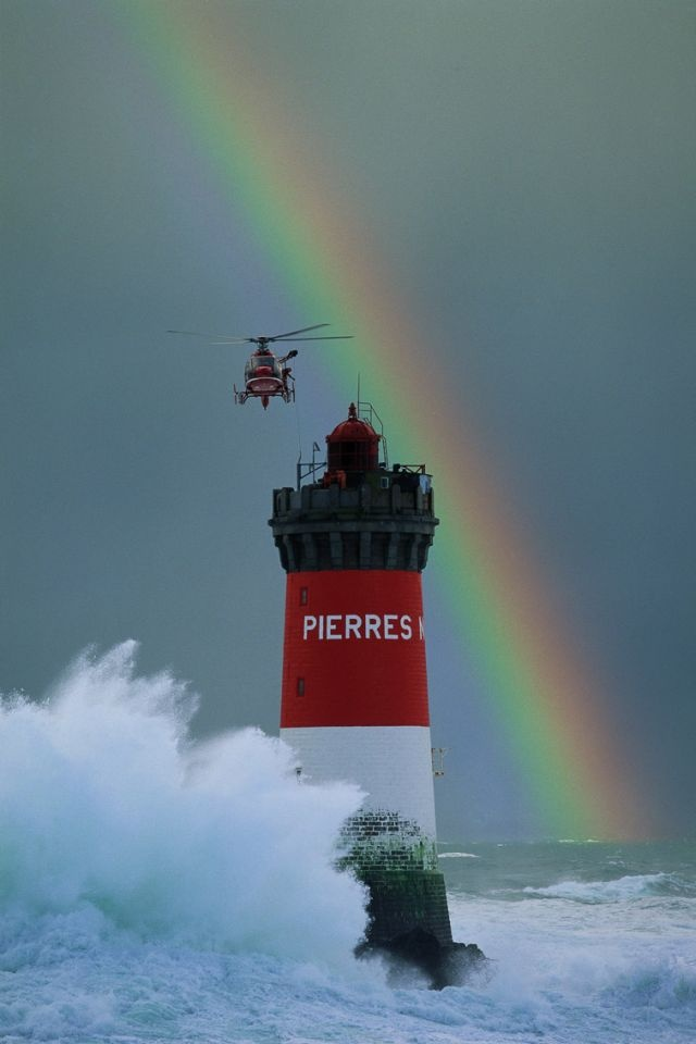 Pierres Noires Lighthouse, helicopter, rainbow Location City: Le Conquet Region: Brittany Country: France