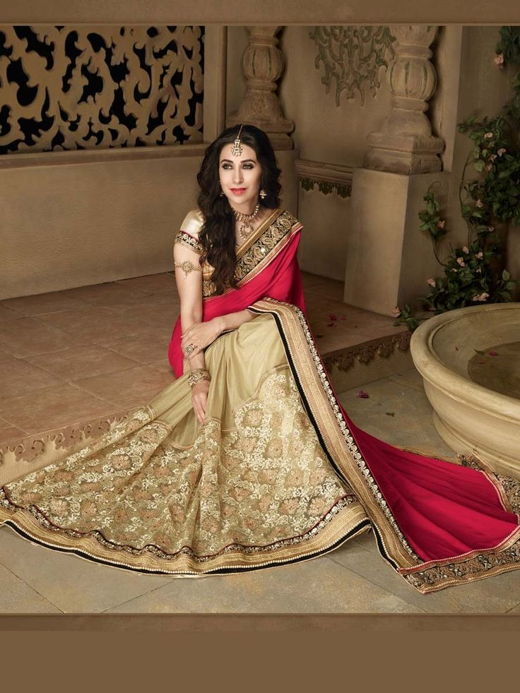 Exquisite red and beige color saree with resham, sequins, zari, kundan, pearls, mirror work. Item Code: SDH10123 http://www.bharatplaza.com/new-arrivals/sarees.html