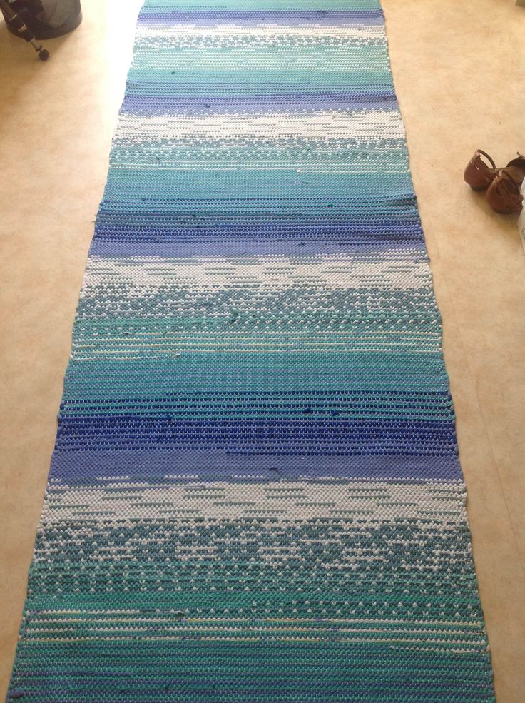 My precious rag rug that I like a newbie weaved summer 1993 on my grandmothers loom. I love the sea colors, especially the Mediterranean, so I found my own pattern and have loved the rug since then