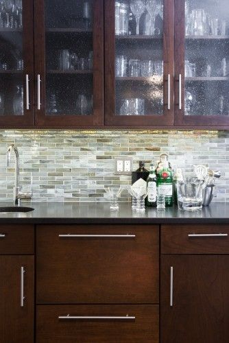 Backsplash thin tile with dark granite and dark cabinets