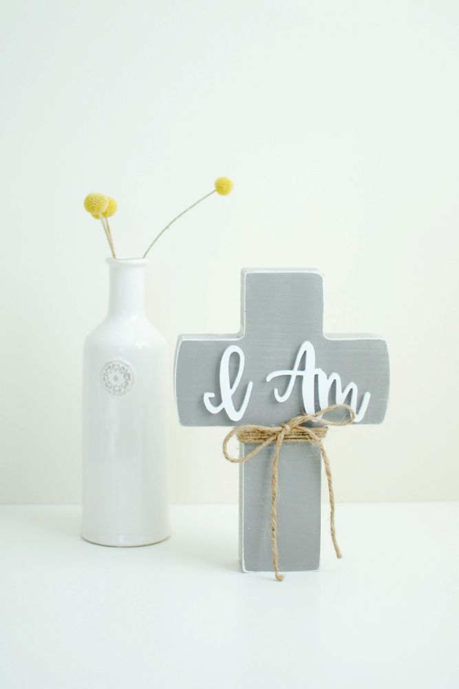 "This wooden ""I AM"" cross is a beautiful reminder that Jesus is not only everything we need, He's everything we could ever want.   Prop it up in your home to remind you of Jesus' seven ""I AM"" statements found in the book of John — and the promise each one holds."