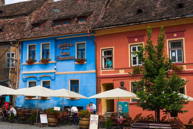 Walking in the old medieval city of Sighisoara, I found these two old houses, renovated, with strong colors. Go there if you are  around, you will find many great things to capture.