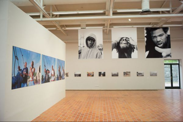 """Installation """"Uncategorized"""", by Chi Modu features massive digitally printed photographs on Dibond aluminum composite material. Chi Modu had the opportunity to meet with some of the founders of hip-hop culture, in their early days before profound fame. He captured these individuals as human beings not celebrities. #dibond #photography #exhibition"""