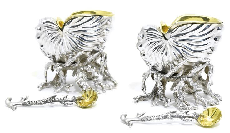 A pair of Victorian silver salt cellars and liners with a pair of salt spoons, R. & S. Garrard & Co., London, 1851