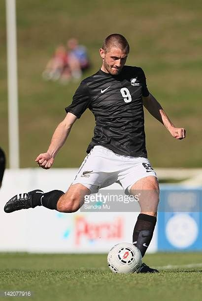 Greg Draper of New Zealand kicks the only goal during the OFC Men's Olympic Qualifier match between New Zealand and Fiji at Owen Delany Park on March...