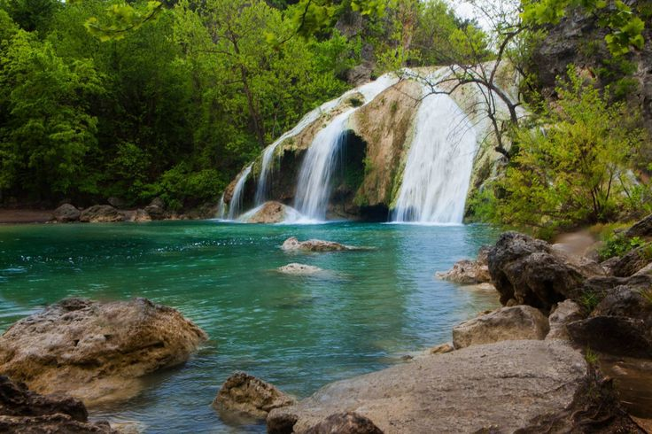Turner Falls. Not only is the 77ft waterfall and cold refreshing streams beautiful but we also have hiking trails, caves to explore, camp sites, cabin rentals, great food, and so much more to see in the heart of the Arbuckle Mountains!  Wildlife are often spotted around the park and the winter the streams are stocked with trout offering some of the best trout fishing in the state!